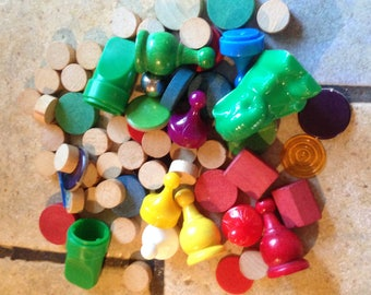 64 Assorted Wooden, Acrylic, and Chip Board Game Pieces and Pawns
