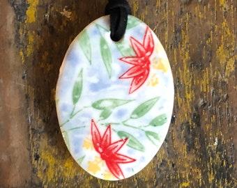 Porcelain oval pendant - oriental lily