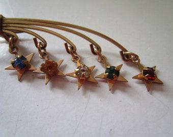 Gold toen Pin w/Five Dangle Stars w/ Stones