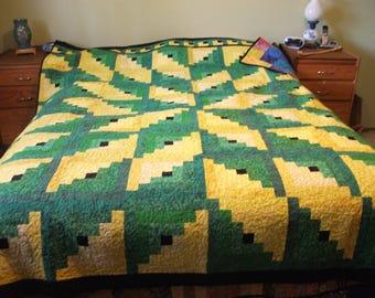 Log cabin with starburst pattern.