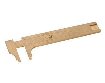 Solid Brass GaugeHandy pocket size solid brass vernier gauge for measuring lengths and diameters up to 100mm