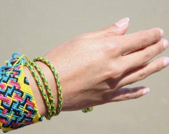 handmade custom woven friendship bracelet. women.girls. boys. beach. festival. summer.bright.sunny. knotted. pattern.blue.yellow.pink.black.