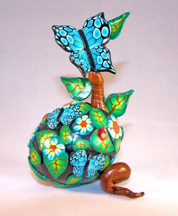 Handmade decorated egg and holder, hatching its own new growth and beautiful butterfly