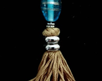 Unique wearable tassels made from new and repurposed jewelry.