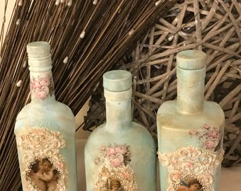 3 beautiful bottle. Made by the art of Decoupage , made with real love for the Art xxxx