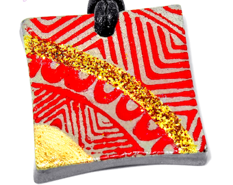 Modern necklace square medallion screenprint, red and gold on cement gray jewelry with leather cord