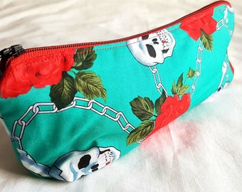 Skull and roses make up bag or pencil case with heart lining
