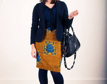 Man in blue and orange African print wax pencil skirt