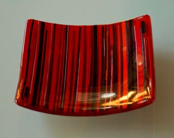Red and black striped sushi platter