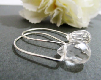 Silver earrings with natural crystal In the form of tear drop