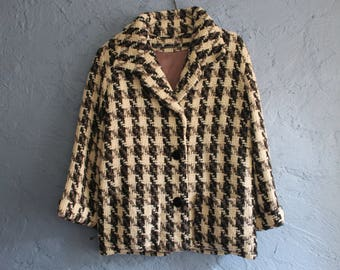 Genuine vintage couture black & white houndstooth jacket. Excellent condition.