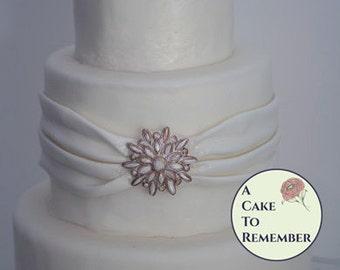Cake bling decorations for a DIY wedding cake edible brooch. Edible jewels, edible cake jewels,  sugar gems, gumpaste brooch for cakes.