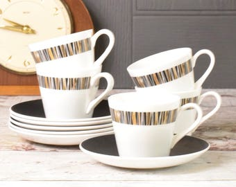 Set of five bone china teacups and saucers. Mid Century retro monochrome design with black saucers