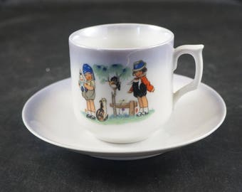 Vintage Child's Porcelain Tea Cup and Saucer GERMANY Girls with Cat and Bird
