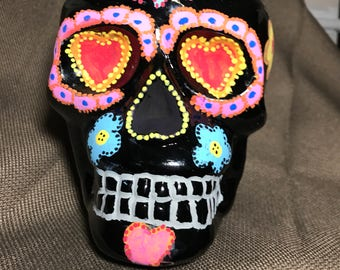 Black colored sugar skull with hearts