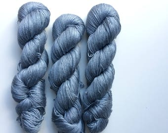 New edition Hand dyed yarn 4ply finger weight merino and silk 100g. In Grey denim Non mulesed ethically sourced.