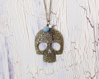 Sugar Skull Necklace with flower, pearl and key charms - Antique Brass
