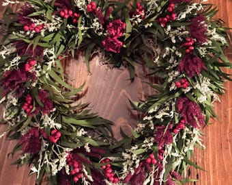 Heart shaped red dried floral wreath