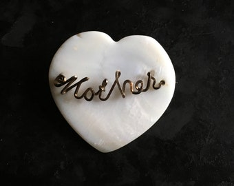 """Hand made """"Mother""""  brooch of brass wire on a mother of pearl heart. You found it here!"""