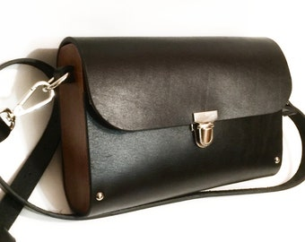 Black, female mini-bag over the shoulder, with a metal lock