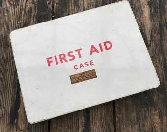 FIRST AID TIN : A vintage red and white first aid kit, with original contents and in a good condition.
