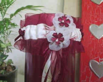 Burgundy and ivory satin garter