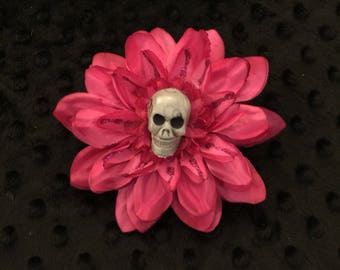 Hot pink flower hair clip with a skeleton skull