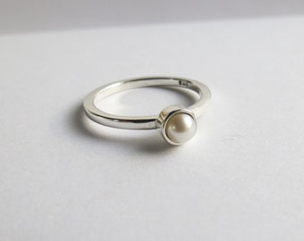 Custom Minimalist Freshwater Pearl Solitaire Engagement Ring. Custom Sterling Silver and Pearl Ring.