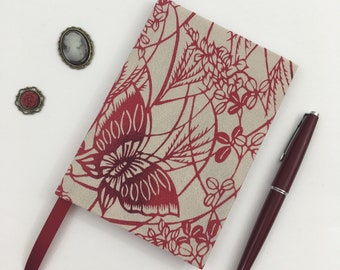 A6 Lined Notebook Hand Covered in a vintage kimono chirimen silk fabric, featuring red butterflies