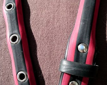 Red and black belt made from a recycled bike tire, with eyelets - 2,8cm wide