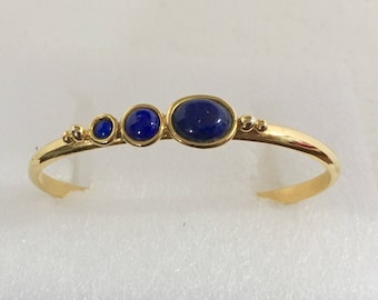 Gold plated brass cuff bracelet with lapis stones