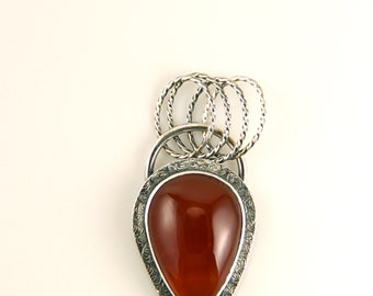 Carnelian pendant  with embossed sterling silver setting