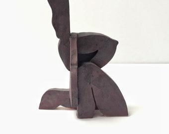 Abstract seated figure, ceramic sculpture, modernist art, living room art