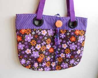 Large flowered grommet handbag