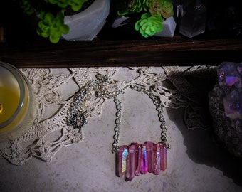 Love Witch • Seven iridescent and flashy pink titanium aura crystals necklace