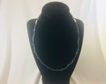 Blue and silver colored spiral coiled wire necklace