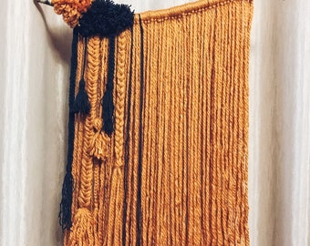 Boho wall hanging in orange & black  yarn