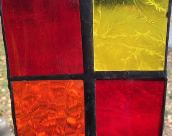 red, yellow and orange stained glass squares