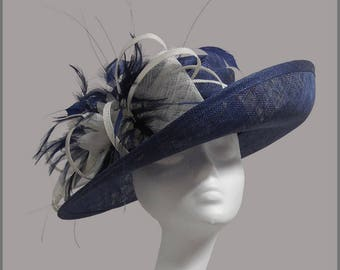 Beautiful navy & white medium ladies hat with feathers and sinamay. Weddings, races, ladies day or special occasion.