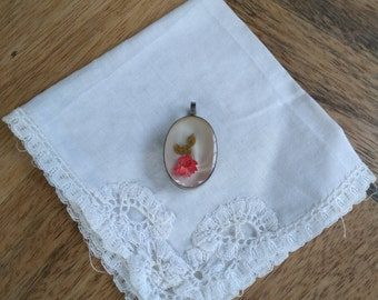 Pendant oval framed dried flower