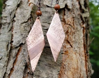 Handmade textured copper earrings.