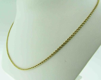 18 K gold rope chain.