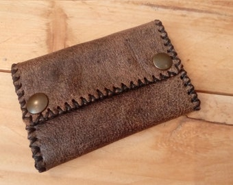 Hand-stitched leather wallet.