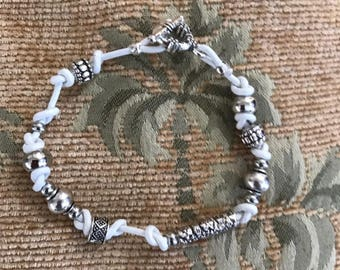 braclet   White leather with antique silver beads  & a nice toggle clasp