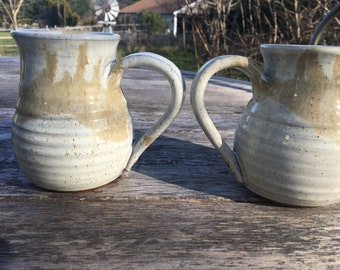 Set of Two handmade rustic pottery mugs grey and tan terra cotta with flower detail on handle
