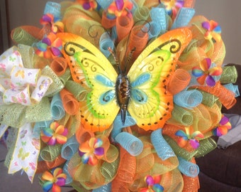 Buy 1 get 5.00 off your 2nd item Butterfly Wreath