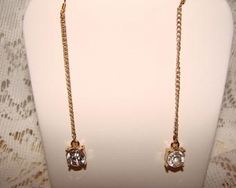 Pair Of Dangle Earring With A Diamond Shape Rhinestone