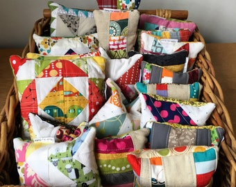 Quilted pin cushions with crushed walnut shell stuffing