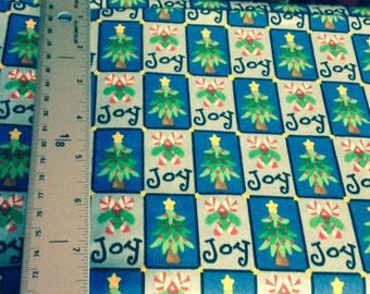 44inch wide cotton Christmas fabric joy candy canes Christmas tree on blue square