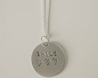 Smile handstamped necklace with three crooked hearts